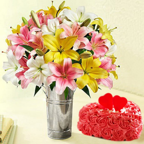 7 Assorted Asiatic Lilies with 1 Kg Heart Shape Vanilla Rose Cake in a Vase