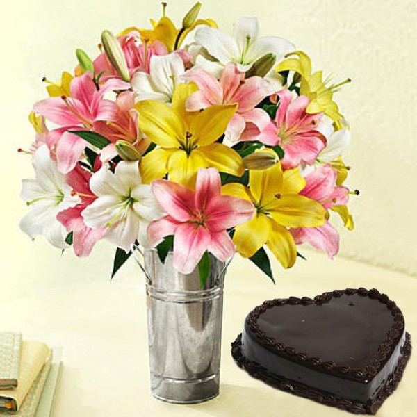 7 Assorted Asiatic Lilies with 1 Kg Heart Shape Chocolate Cake in a Vase