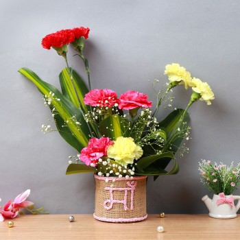 "8 Mixed Carnations (Red,Pink,Yellow) in Glass Vase wrapped with jute packing and ""Ma"" written on it"