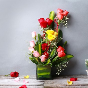 18 Mixed Roses (Red,Light Pink,Yellow,Orange) in Glass Vase with leaves