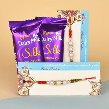 2 Pearl Rakhis N Dairy Milk Silk Chocolates