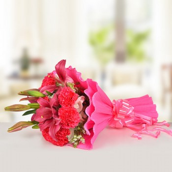 10 Pink Carnations and 6 Pink Asiatic Lilies in Paper Packing