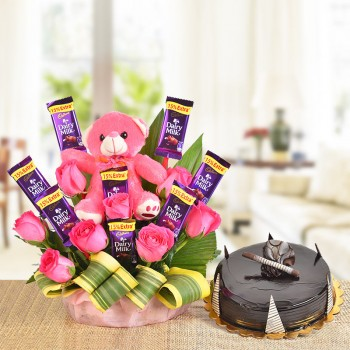 A Basket Arrangement of 8 Pink roses, 8 Cadbury's Dairy Milk of 13 gms each and a pink Teddy bear (6 Inches) with dracaena leaves with Half Kg Chocolate Truffle Cake