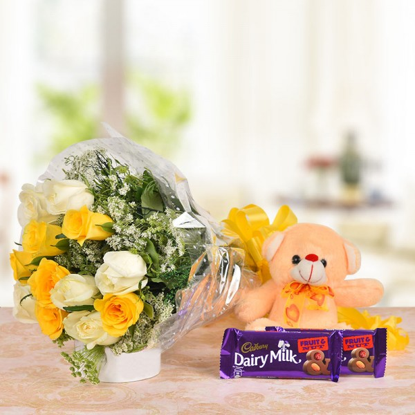 6 Yellow Roses and 6 White Roses with 2 Dairy Milk Fruit & Nut Chocolates (38 gms each) and 1 Brown Teddy Bear (6 Inches)