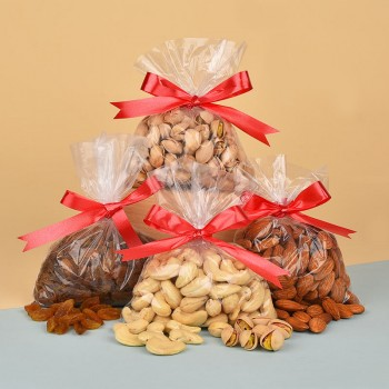 Pack of Almonds (100 gms), Cashew Nuts (100 gms), Raisins (100 gms) and Pistachios (100 gms)