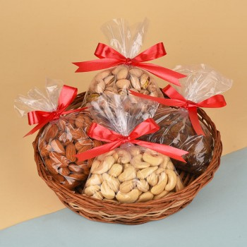 A Cane Basket containing Almonds (200 gms), Cashew Nuts (200 gms), Raisins (200 gms) and Pistachios (200 gms)