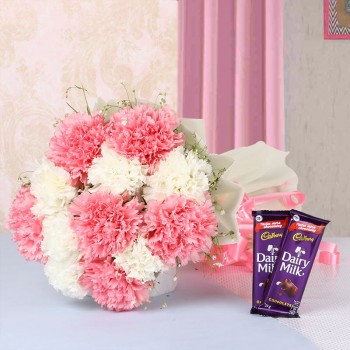 12 Carnations (Pink and White) in White Paper packing with 2 Cadbury Dairy Milk Chocolates (25gms each)
