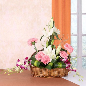 Floral Arrangement of 4 White Asiatic Lilies, 5 Pink Carnations and 4 Purple Orchids in a Basket