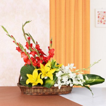 Floral Arrangement is the best gift ever. It has 3 Yellow Asiatic Lilies, 4 Red Glads and 3 White Orchids in a Basket