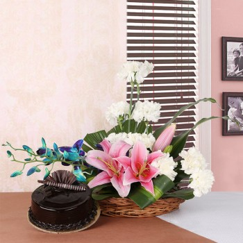 Floral Arrangement like this one. It includes 2 Pink Asiatic Lilies, 10 White Carnations and 2 stems of Blue Orchid in a Basket with Chocolate Truffle Cake (Half Kg)