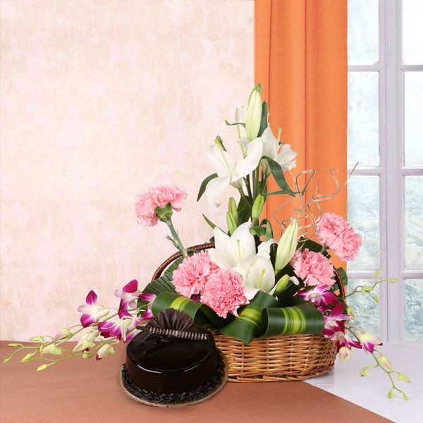 Floral Arrangement of 4 White Asiatic Lilies, 5 Pink Carnations and 4 Purple Orchids in a Basket with Chocolate Truffle Cake (Half Kg)