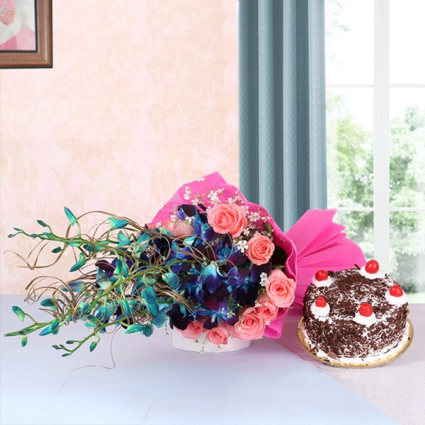 6 Blue Orchids and 12 Pink Roses in Pink Paper packing with Black Forest Cake (Half Kg)