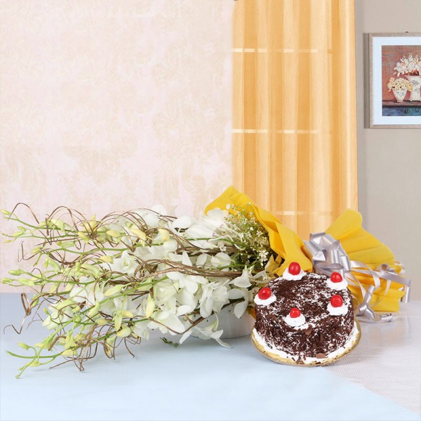 6 White Orchids in Yellow Paper packing with Black Forest Cake (Half Kg)