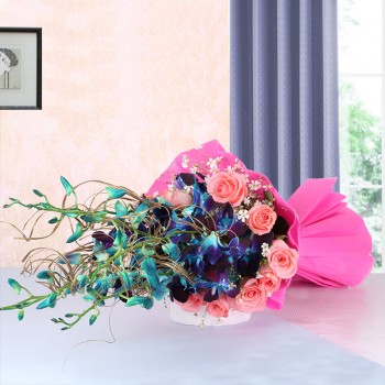 6 Blue Orchids with 12 Pink Roses in Pink Paper packing