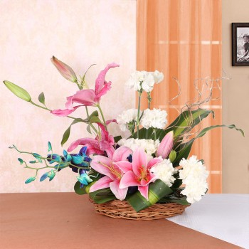 Floral Arrangement of 4 Pink Asiatic Lilies, 10 White Carnations and 2 Blue Orchids in a Basket