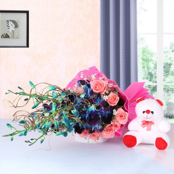 6 Blue Orchids and 12 Pink Roses in Pink Paper packing with Teddy Bear (6 inches)