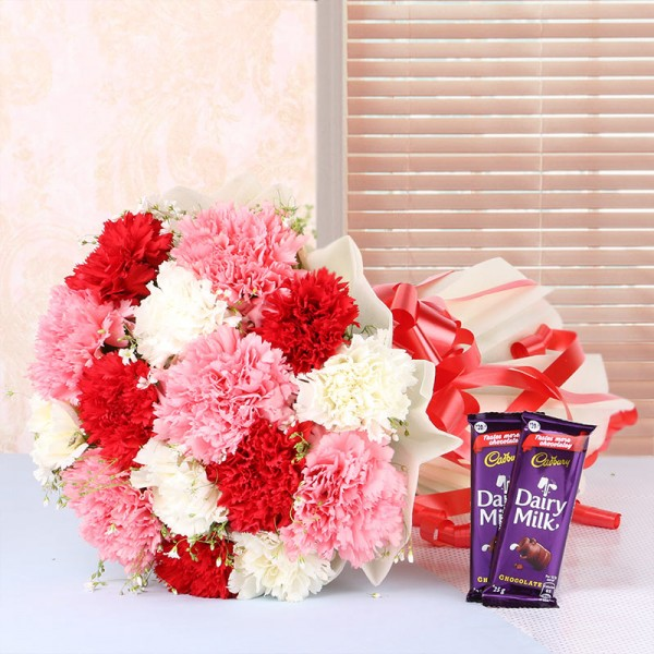 12 Mix Carnations in White Paper packing with 2 Cadbury Dairy Milk Chocolates (25gms each)