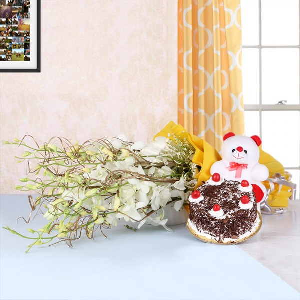 6 White Orchids in Yellow Paper packing with Black Forest Cake (Half Kg) and Teddy Bear (6 inches)