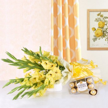 10 Yellow Gladiolus (Glads) in White Packing paper with A Box of 16 Pcs Ferrero Rocher Chocolates