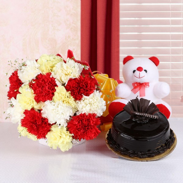 15 Carnations (Yellow, White and Red) in Red Paper packing with Chocolate Truffle Cake (Half Kg) and Teddy Bear (6 inches)