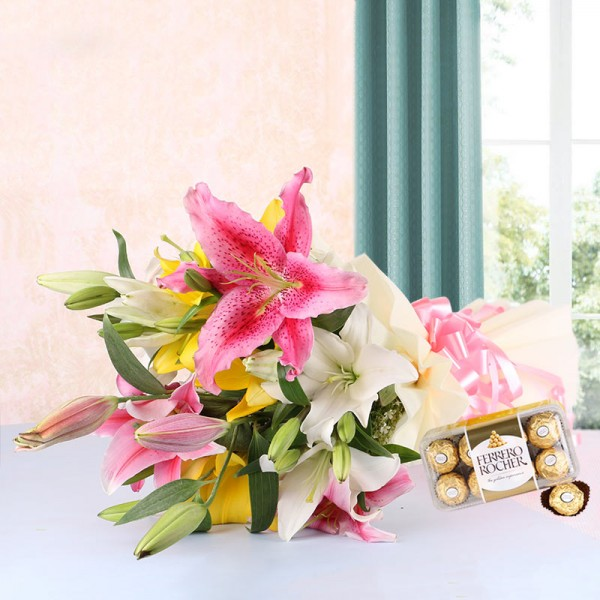 10 Assorted Asiatic Lilies in White Paper packing with a box of 16 pcs of Ferrero Rocher Chocolates