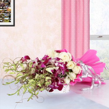 6 Purple Orchids with 12 White Roses in Pink paper packing