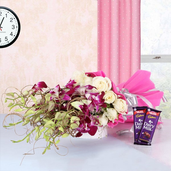 6 Purple Orchids and 12 White Roses in Pink paper packing with 2 Cadbury Dairy Milk Chocolates (25gms each)
