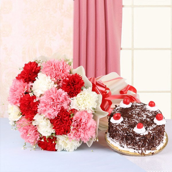 15 Mix Carnations in White Paper packing with Black Forest cake (Half Kg)