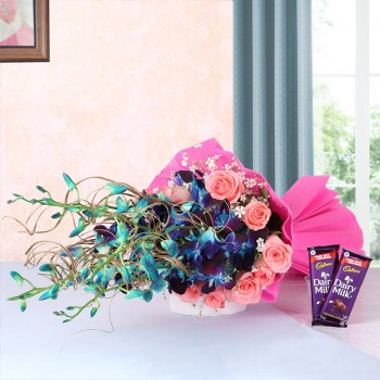 6 Blue Orchids and 12 Pink Roses in Pink Paper packing with 2 Cadbury Dairy Milk Chocolates (25gms each)