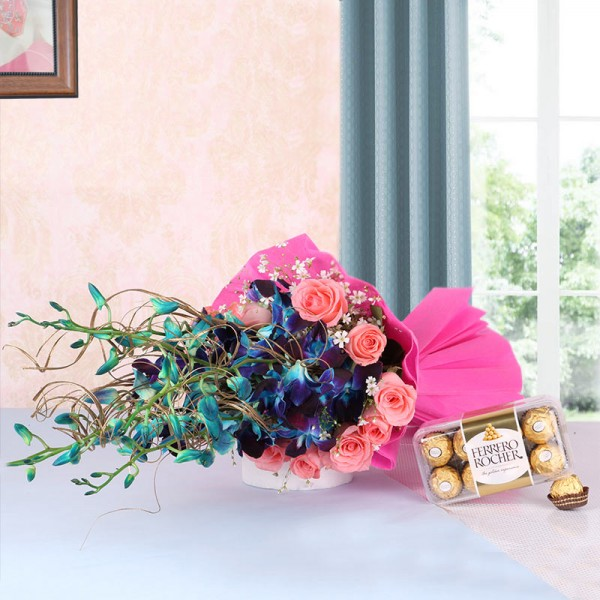 6 Blue Orchids and 12 Pink Roses in Pink Paper packing with a box of 16 pcs of Ferrero Rocher Chocolates