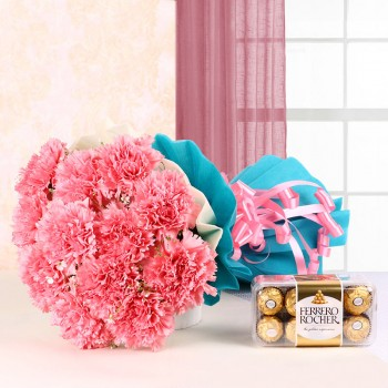 12 Pink Carnations in Blue and White Paper Packing with a box of 16 pcs of Ferrero Rocher Chocolates