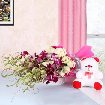 6 Purple Orchids and 12 White Roses in Pink paper packing with Teddy Bear (6 inches)