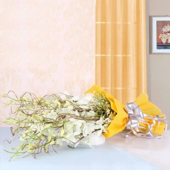 6 White Orchids in Yellow Paper packing