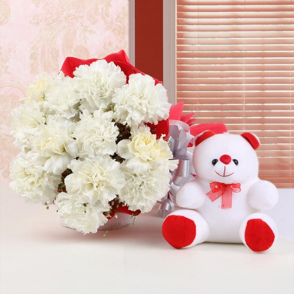 12 White Carnations in Red Paper Packing with Teddy Bear (6 inches)