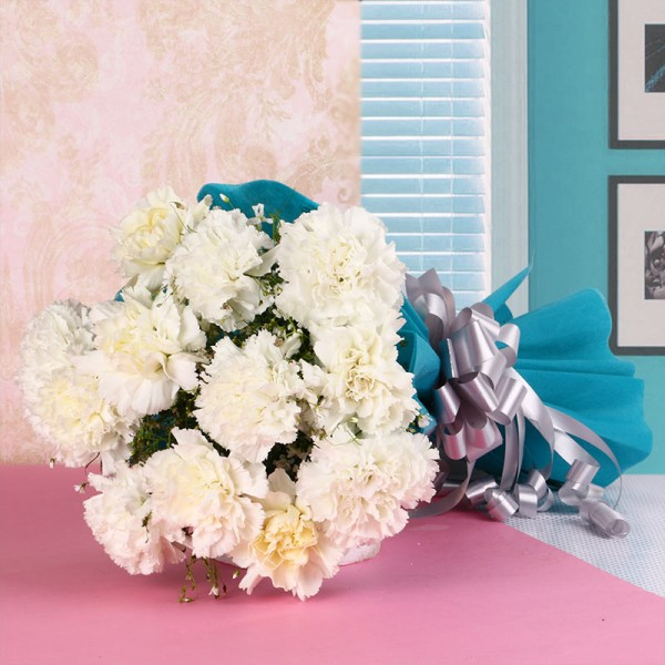 12 White Carnations in Blue Paper Packing