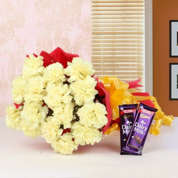 15 Yellow Carnations in Red Paper Packing with 2 Cadbury's DairyMilk Chocolates (25gms each)