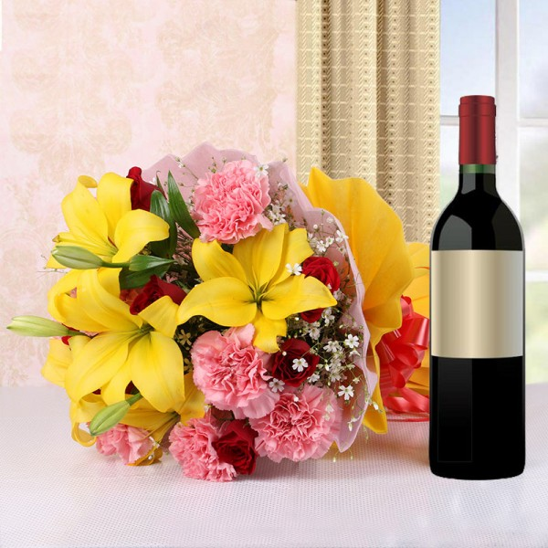 5 Yellow Asiatic Lilies and 8 Red Roses and 8 Pink Carnations in Pink and Yellow Paper with 1 Bottle of Red Wine