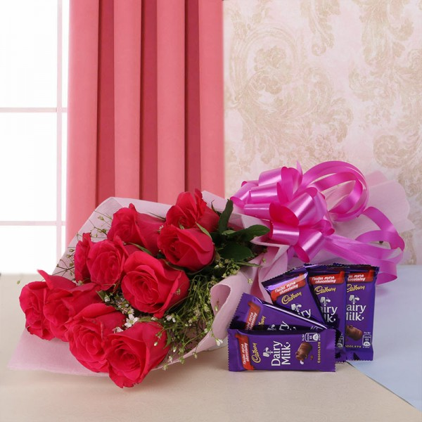 10 Hot Red Roses in Pink Paper, Pink Bow with 5 DairyMilk (13gms each)