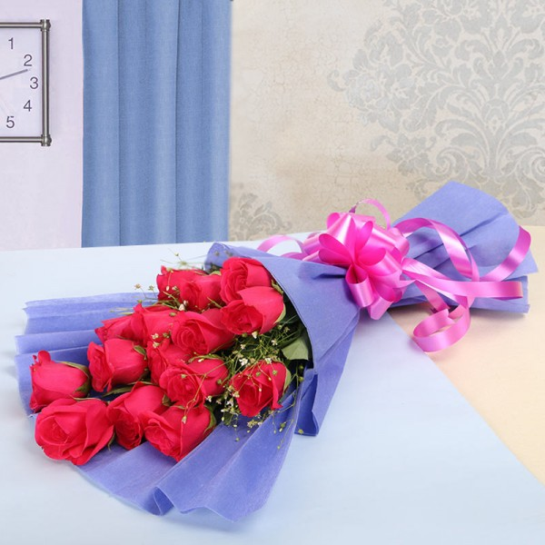 12 Hot Pink Roses in Purple Paper Packing