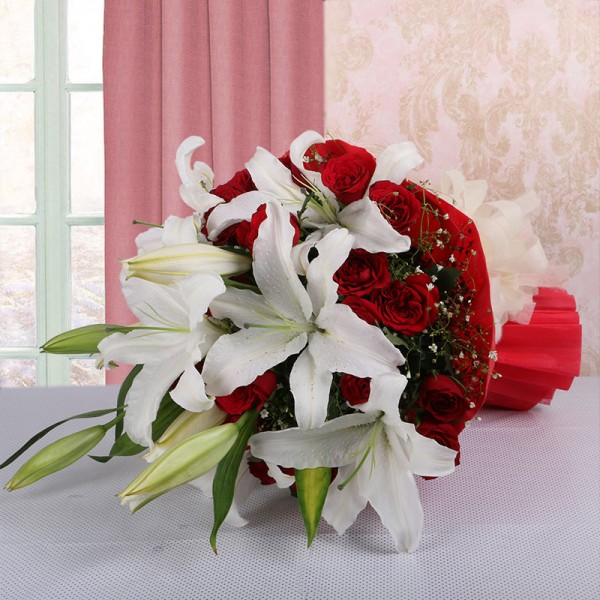 4 White Asiatic Lilies with 15 Red Roses in Paper Packing