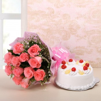 10 Pink Roses in Pink Paper with Pineapple Cake (Half Kg)