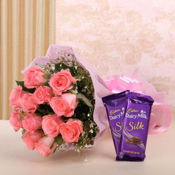 12 Pink Roses in Pink Paper with 2 Cadbury's Silk (60 gms each)