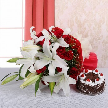 4 White Asiatic Lilies and 15 Red Roses in Red paper, White paper bow with Back Forest Cake (Half Kg)