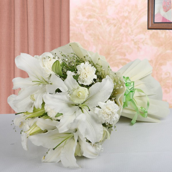 8 White Carnations with 8 White Roses and 4 White Asiatic Lilies in Paper Packing