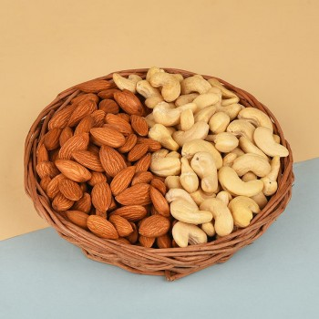 A Cane Basket containing Almonds (250 gms) and Cashew Nuts (250 gms)