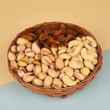 A Cane Basket containing Pistachios (100 gms), Raisins (100 gms) and Cashew Nuts (100 gms)