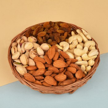 A Cane Basket containing Almonds (100 gms), Raisins (100 gms), Pistachios (100 gms) and Cashew Nuts (100 gms)