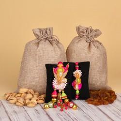 Lumba Rakhi N Dry Fruits Potlis