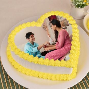 1 Kg Heart Shape Photo Pineapple Cake for Raksha Bandhan