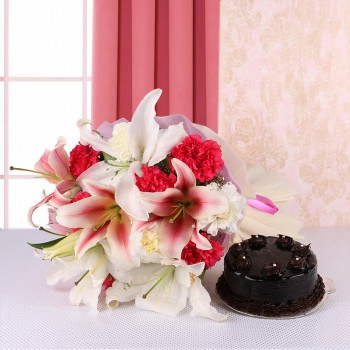 8 Pink and White Carnations and 2 Oriental Pink Lilies - 2 White Asiatic Lilies in Pink and White Paper with Chocolate Truffle Cake (Half Kg)